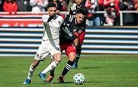 WASHINGTON, DC - FEBRUARY 29: Junior Moreno #5 of DC United and Younes Namli #21 of the Colorado Rapids battle for the ball during a game between Colorado Rapids and D.C. United at Audi Field on February 29, 2020 in Washington, DC.