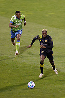 COLUMBUS, OH - DECEMBER 12: Gyasi Zardes #11 of Columbus Crew kicks the ball ahead of Nouhou #5 of Seattle Sounders FC during a game between Seattle Sounders FC and Columbus Crew at MAPFRE Stadium on December 12, 2020 in Columbus, Ohio.