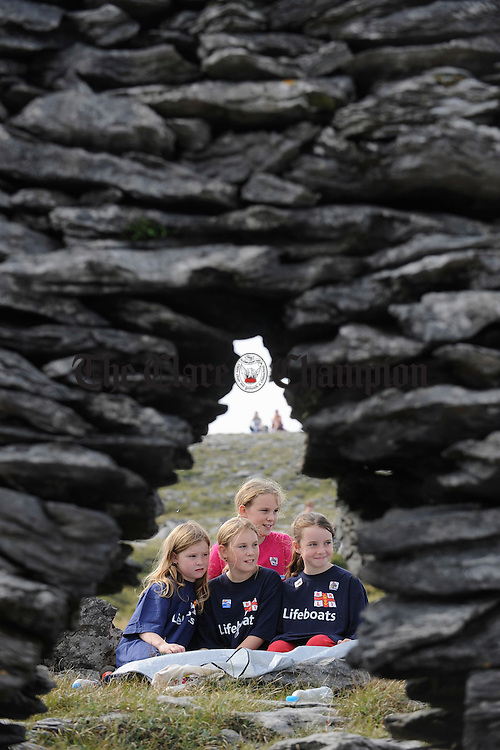 Twins Brianna and Ciara Nash with Alanah Nash and Saidbh Burke Mc Guire take a break on Black Head Mountain during the Burren Ramble in aid of the Lifeboats. Photograph by John Kelly.