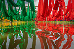 Reflection of hanging fabrics in water by Touhid Parvez Biplob