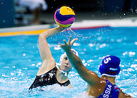 30 JUL 2012 - LONDON, GBR - Fiona McCann (GBR) (left) of Great Britain prepares to shoot during the women's London 2012 Olympic Games water polo qualification match against Russia in the Olympic Park Water Polo Arena in Stratford, London, Great Britain .(PHOTO (C) 2012 NIGEL FARROW)