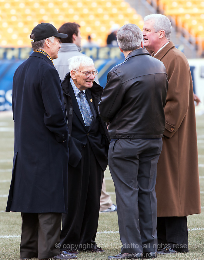 Pittsburgh Steelers owner Dan Rooney (with glasses and 2nd from the left) talks with son Art Rooney II (left), Pitt Chancellor Mark Nordenberg (back tuned) and Pitt Athletic Director Steve Pederson. The Miami Hurricanes defeated the Pitt Panthers 41-31 at Heinz Field, Pittsburgh, Pennsylvania on November 29, 2013.