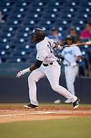 Tampa Tarpons center fielder Estevan Florial (34) follows through on a swing during a game against the Daytona Tortugas on April 18, 2018 at George M. Steinbrenner Field in Tampa, Florida.  Tampa defeated Daytona 12-0.  (Mike Janes/Four Seam Images)