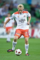 MELBOURNE, AUSTRALIA - DECEMBER 03: Mitch Nichols of the Roar passes the ball during the round 17 A-League match between the Melbourne Victory and the Brisbane Roar at AAMI Park on December 3, 2010 in Melbourne, Australia. (Photo by Sydney Low / Asterisk Images)
