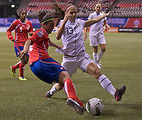 Alex Morgan, right, of the United States blocks the pass of Carol Sanchez of Costa Rica during play in the CONCACAF Olympic Qualifying semifinal match at BC Place in Vancouver, B.C., Canada Friday Jan. 27, 2012. The United States won the match 3-0 to earn a berth in 2012 London Olympics.