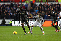Wednesday, 01 January 2014<br /> Pictured: (L-R) Yaya Toure, Jose Canas.<br /> Re: Barclay's Premier League, Swansea City FC v Manchester City at the Liberty Stadium, south Wales.