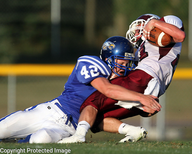 CANTON, SD - AUGUST 26: Kase Jacobs #42 of Canton brings down Andrew Buchmann #21 of Tri-Valley in the first quarter of their game Friday night at Canton High School.  (Photo by Dave Eggen/Inertia)