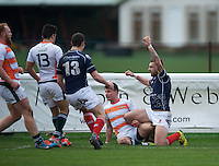 Rory Hughes of London Scottish Football Club claims a try during the Greene King IPA Championship match between London Scottish Football Club and Ealing Trailfinders at Richmond Athletic Ground, Richmond, United Kingdom on 26 December 2015. Photo by Alan  Stanford / PRiME Media Images