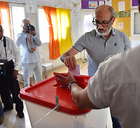 10A Tunisian voter casts her ballot at a polling station in the capital Tunis on October 13, 2019 during the second round of the presidential election. - Tunisians began voting today in a presidential runoff pitting conservative law professor Kais Saied against media magnate Nabil Karoui, who was released from prison just days earlier.