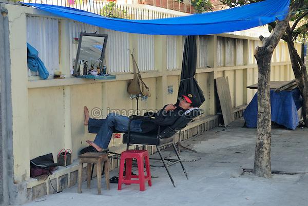 Asia, Vietnam, Nha Trang. Typical road side hair salon.