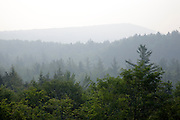 A smokey haze from Quebec, Canada wildfires in 2010 can be seen along the Kancamagus Highway (route 112), which is one of New England's scenic byways in the White Mountains, New Hampshire USA