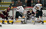 """19 January 2007: Boston College goaltender Corey Schneider from Marblehead, MA, makes a save during a Hockey East matchup against the University of Vermont at Gutterson Fieldhouse in Burlington, Vermont. The UVM Catamounts defeated the BC Eagles 3-2 before a record setting 50th consecutive sellout at """"the Gut""""...Mandatory Photo Credit: Ed Wolfstein Photo."""