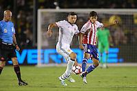 Pasadena, CA - Tuesday June 07, 2016: Colombia midfielder Daniel Torres (16) and Paraguay midfielder Oscar Romero (21) during a Copa America Centenario Group A match between Colombia (COL) and Paraguay (PAR) at Rose Bowl Stadium.
