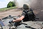 UKRAINE, Pisky: Chemic and Yassin went with a tank to the frontline in order to check shelling near the airport of Donetsk. <br /> <br /> UKRAINE, Pisky: Chemic et Yassin -noms de guerre- sur un tank afin d'aller vérifier les bombardements près de l'aéroport de Donetsk.