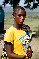 TANZANIA Region Mara, Musoma, village Borenga, Kuria tribe, the Kuria practise ritual FGM Female Genital Mutilation , Kuria woman was mutilated by her husband for revenge, he has choped of her right hand / TANSANIA Region Mara, Musoma, Dorf Borenga, Kuria Ethnie, Kuria praktizieren rituelle weibliche Genitalbeschneidung, Kuria Frau wurde von ihrem Mann verstuemmelt, er hat ihre Hand aus Rache abgehackt