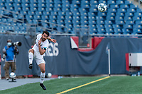 FOXBOROUGH, MA - JULY 25: USL League One (United Soccer League) match. Austin Panchot #12 of Union Omaha keeps ball in play during a game between Union Omaha and New England Revolution II at Gillette Stadium on July 25, 2020 in Foxborough, Massachusetts.