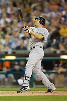 Mark Teixeira #25 of the New York Yankees follows through on his swing against the Detroit Tigers at Comerica Park April 27, 2009 in Detroit, Michigan.  Photo by Brian Westerholt / Four Seam Images