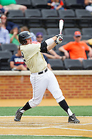 Will Craig (22) of the Wake Forest Demon Deacons follows through on his swing against the Virginia Cavaliers at Wake Forest Baseball Park on May 17, 2014 in Winston-Salem, North Carolina.  The Demon Deacons defeated the Cavaliers 4-3.  (Brian Westerholt/Four Seam Images)