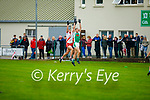 Na Gaeil's Jack Barry and Eanna O'Conchuir of An Ghaeltacht take to the air for possession in the Intermediate Club Football Championship