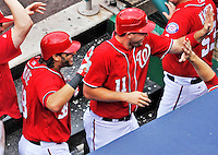 25 September 2011: Washington Nationals outfielder Michael Morse returns to the dugout with teammate Ryan Zimmerman after hitting a 2-run dinger against the Atlanta Braves at Nationals Park in Washington, DC. The Nationals shut out the Braves 3-0 to take the rubber match third game of their 3-game series - the Nationals' final home game for the 2011 season. Mandatory Credit: Ed Wolfstein Photo