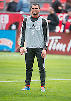 Toronto, Ontario - May 3, 2014: Toronto FC forward Gilberto #9 during the warm-up in a game between the New England Revolution and Toronto FC at BMO Field.<br /> The New England Revolution won 2-1.