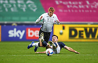 3rd October 2020; Liberty Stadium, Swansea, Glamorgan, Wales; English Football League Championship, Swansea City versus Millwall; Jay Fulton of Swansea City is tackled by Ryan Leonard of Millwall
