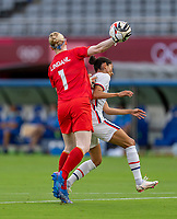 TOKYO, JAPAN - JULY 21: Hedvig Lindahl #1 of Sweden throws the ball past Christen Press #11 of the USWNT during a game between Sweden and USWNT at Tokyo Stadium on July 21, 2021 in Tokyo, Japan.