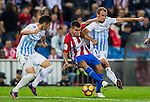 Angel Correa (c) of Club Atletico de Madrid fights for the ball with Federico Ricca Rostagnol and Sergio Paulo Barbosa Valente 'Duda' of Malaga CF during their La Liga match between Club Atletico de Madrid and Malaga CF at the Estadio Vicente Calderón on 29 October 2016 in Madrid, Spain. Photo by Diego Gonzalez Souto / Power Sport Images