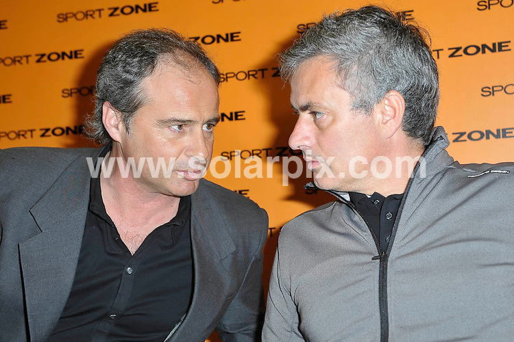 **ALL ROUND PICTURES FROM SOLARPIX.COM**                                             **WORLDWIDE SYNDICATION RIGHTS EXCEPT SPAIN - NO SYNDICATION IN SPAIN**                                                                                  Caption: Real Madrid FC coach Jose Mourinho at a photocall in Madrid, Spain where he presented his new DVD - Training to play. Madrid, Spain. 23 March 2011                                                                          This pic: Jose Mourinho and Luis Campos                                                                                             JOB REF: 13013 DMS       DATE: 23_03_2011                                                          **MUST CREDIT SOLARPIX.COM OR DOUBLE FEE WILL BE CHARGED**                                                                      **MUST AGREE FEE BEFORE ONLINE USAGE**                               **CALL US ON: +34 952 811 768 or LOW RATE FROM UK 0844 617 7637**