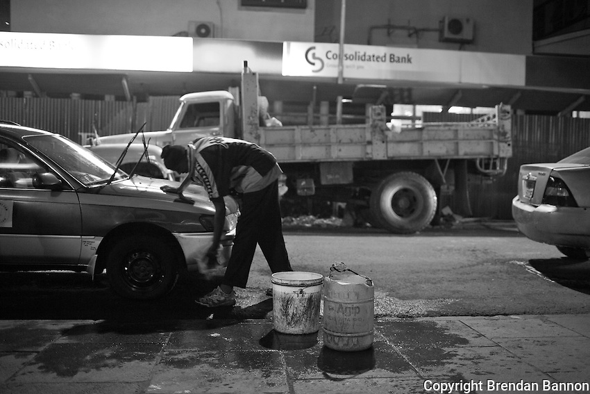 Car wash man John Mbogo, on a friday night in Naiorbi.