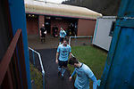 The home team players emerge from the changing rooms before Cambrian and Clydach Vale take on Cwmbran Celtic at King George's New Field in a Welsh League Division One match, the top division of the Welsh Football League and the second level of the Welsh football league system. The club, formed in 1965 reached the final of the 2018-19 League Cup final and can count on ex-England manager Terry Venables as a former club chairman. Cambrian and Clydach Vale won this match 2-0, watch by a crowd of around 100 spectators.