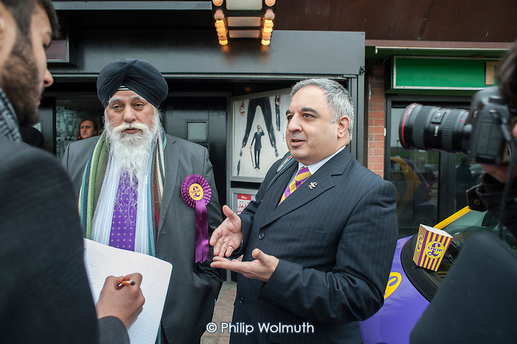 Local UKIP supporters intervewed by a journalist outside the Movie Starr cinema, Canvey Island, South Essex, following the launch of the party's General Election campaign.