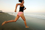 Madison Marquette's Megan Oliviera races to the surf during the Surf Dash event at the First Annual Asbury Park Beach Bar Lifeguard Competition held at the 3rd Avenue beach in Asbury Park.  ASBURY PARK, NJ  8/4/07  8:21:47 PM  PHOTO BY ANDREW MILLS