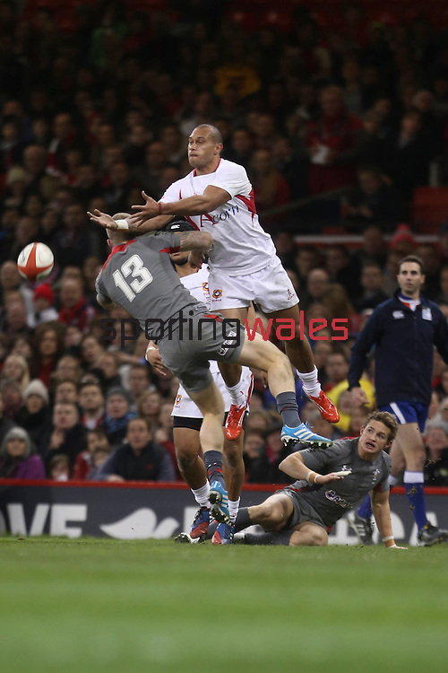 Owen Williams and Fetu'u Vainikolo compete for the high ball.<br /> Dove Men Series 2013<br /> Wales v Tonga<br /> Millennium Stadium - Cardiff<br /> 22.11.13<br /> ©Steve Pope-SPORTINGWALES
