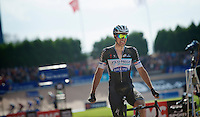 race winner Niki Terpstra (NLD/OPQS) crosses the finish line overpowered with emotions while his competitors sprint for the rest of the podium places in the background<br /> <br /> Paris-Roubaix 2014