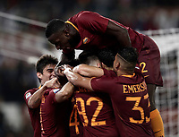 Calcio, Serie A: Roma vs Juventus. Roma, stadio Olimpico, 14 maggio 2017. <br /> Roma's Radja Nainggolan, is hidden by teammates' hugs after scoring during the Italian Serie A football match between Roma and Juventus at Rome's Olympic stadium, 14 May 2017. Roma won 3-1.<br /> UPDATE IMAGES PRESS/Isabella Bonotto
