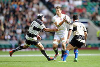 Jon Fisher of England finds his way blocked by Thomas Waldrom and George Smith of Barbarians during the match between England and Barbarians at Twickenham Stadium on Sunday 31st May 2015 (Photo by Rob Munro)