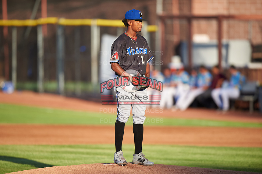 Missoula Osprey starting pitcher Alex Valdez (15) prepares to deliver a pitch during a Pioneer League game against the Idaho Falls Chukars at Melaleuca Field on August 20, 2019 in Idaho Falls, Idaho. Idaho Falls defeated Missoula 6-3. (Zachary Lucy/Four Seam Images)