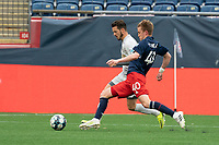 FOXBOROUGH, MA - APRIL 17: Sean O'Hearn #40 of New England Revolution II tackles Jonathan Bolanos #17 of Richmond Kickers during a game between Richmond Kickers and Revolution II at Gillette Stadium on April 17, 2021 in Foxborough, Massachusetts.