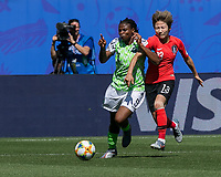 GRENOBLE, FRANCE - JUNE 12: Desire Oparanozie #9 of the Nigerian National Team attempts to control the ball as Minji Yeo #13 of the Korean National Team pressures during a game between Korea Republic and Nigeria at Stade des Alpes on June 12, 2019 in Grenoble, France.