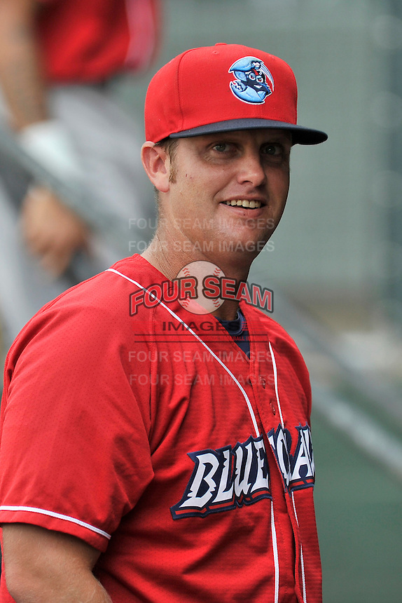 Manager Shawn Williams (22) of the Lakewood BlueClaws in the dugout as his team prepares for a game against the Greenville Drive on Sunday, June 26, 2016, at Fluor Field at the West End in Greenville, South Carolina. Greenville won, 2-1. (Tom Priddy/Four Seam Images)