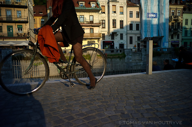 A woman gets on her bicycle in Ljubljana, Slovenia on Sept. 21, 2011.
