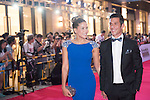 Luis Garcia (necktie) and his wife Katerine (blue dress) during the Red Carpet event at the World Celebrity Pro-Am 2016 Mission Hills China Golf Tournament on 20 October 2016, in Haikou, China. Photo by Weixiang Lim / Power Sport Images