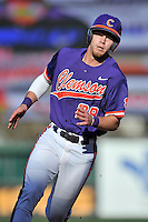 Right fielder Seth Beer (28) of the Clemson Tigers rounds third base, heading home in the Reedy River Rivalry game against the South Carolina Gamecocks on Saturday, March 5, 2016, at Fluor Field at the West End in Greenville, South Carolina. Clemson won, 5-0. (Tom Priddy/Four Seam Images)