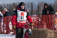 Jen Seavey team leaves the start line during the restart day of Iditarod 2009 in Willow, Alaska