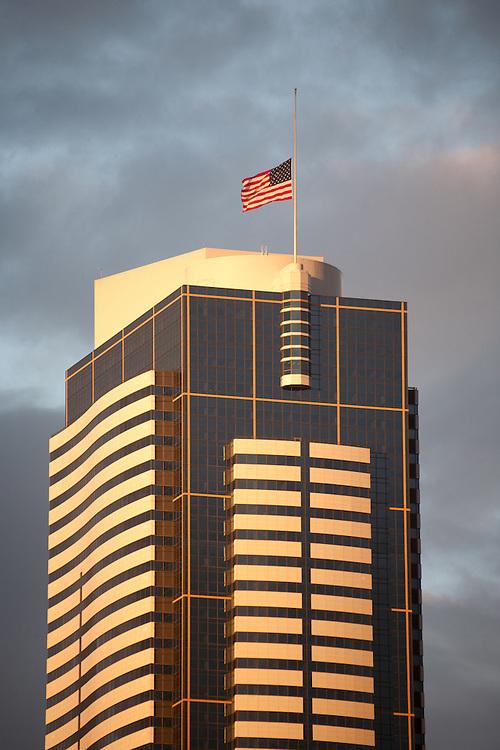 Seattle, Two Union Square Building, American flag at half mast, sunset, Washington State, USA,