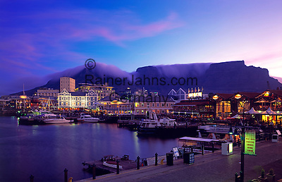 South Africa, Cape Town, V & A Waterfront and Table Mountain at dusk
