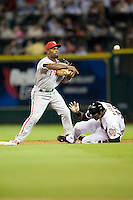 Philadelphia Phillies shortstop Jimmy Rollins #11 turns a double play during the Major League Baseball game against the Houston Astros at Minute Maid Park in Houston, Texas on September 12, 2011. Houston defeated Philadelphia 5-1.  (Andrew Woolley/Four Seam Images)