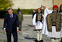 Pictured: Turkey president Recep Tayyip Erdogan deposits a wreath at the Unknown Soldier Monument outside the Greek Parliament in Syntagma Square.<br /> Re: Turkey's president Recep Tayyip Erdogan has begun a landmark visit to Greece. Thursday 07 December 2017