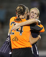 Nikki Marshall #17 hugs Ashley Harris #24 of the Washington Freedom at the end of a WPS match against the Philadelphia Independence on August 4 2010 at the Maryland Soccerplex, in Boyds, Maryland. Freedom won 2-0.